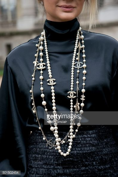 PARIS, FRANCE - OCTOBER 6: Fashion Blogger Thassia Naves wears a Chanel necklace, skirt and shirt on day 8 during Paris Fashion Week Spring/Summer 2016/17 on October 6, 2015 in London, England. (Photo by Kirstin Sinclair/Getty Images)*** Local Caption *** Thassia Naves